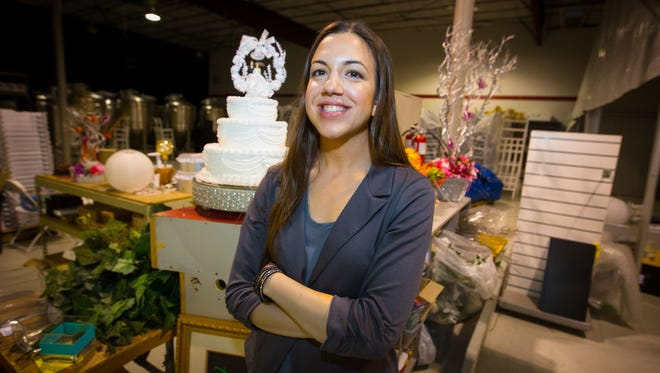 Deanna Green, of Enchanted Occasions, stands in the businesses' over 5,000-square-foot warehouse April 9, 2016.