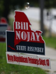Signs supporting deceased Assemblyman Bill Nojay who