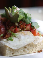 Ranchero Roll, served with or without bacon, has egg,