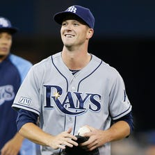 Drew Smyly pitched a two-hitter and retired the final 19 Toronto batters for the first complete game of his career.