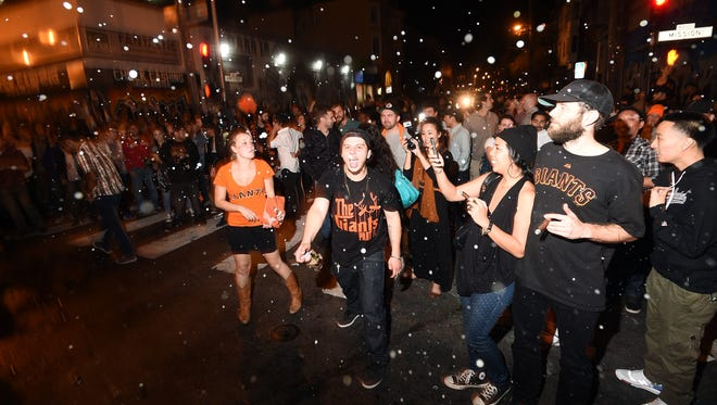 Fans celebrate in the Mission district after the San Francisco Giants beat the Royals.