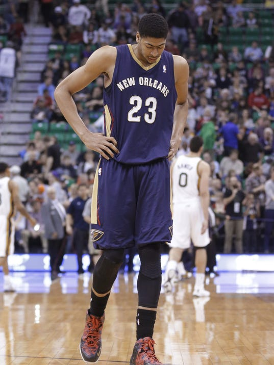 New Orleans Pelicans' Anthony Davis walks off the court at the end of the first half of the Pelicans' NBA basketball game against the Utah Jazz on Friday, April 4, 2014, in Salt Lake City. The Jazz won 100-96. (AP Photo/Rick Bowmer)