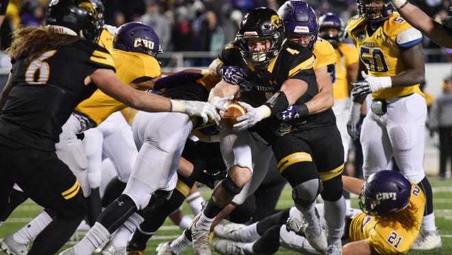 UW-Oshkosh running back Dylan Hecker reaches across the goal line to score a touchdown against Mary Hardin-Baylor.