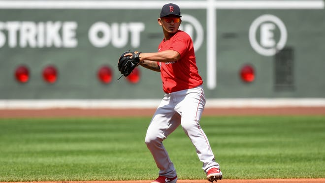 Boston's Tzu-Wei Lin makes a throw from third base during a workout last week at Fenway Park.
