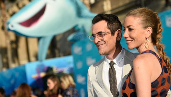 """Ty Burrell, left, and Holly Burrell arrive at the premiere of """"Finding Dory"""" at the El Capitan Theatre on Wednesday, June 8, 2016, in Los Angeles."""