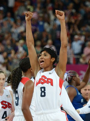 Former U of L and current US guard Angel McCoughtry celebrates winning 86-50 against France during the London 2012 Olympic Games women's gold medal basketball game between the USA and France at the North Greenwich Arena in London on August 11, 2012. She will compete with Team USA's women's basketball at the 2016 Rio de Janeiro Olympic Games.