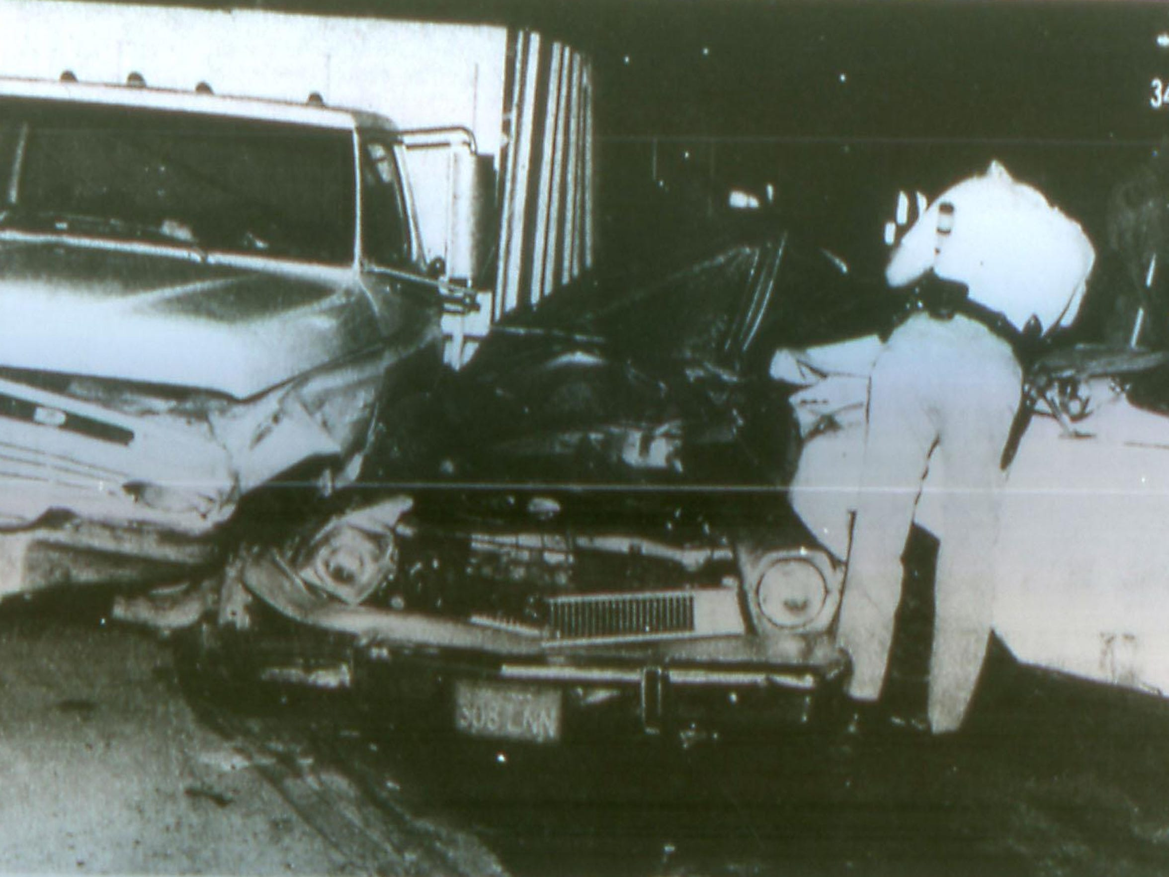 A Ford Pinto was crushed between two vehicles during