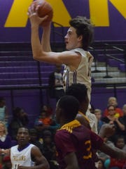 ASH's Connor Grigg (14) goes for two against Natchitoches