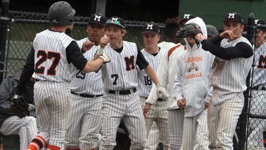 Mamaroneck's Mark Adamo is congratulated after scoring during a varsity baseball game at Mamaroneck High School April 28, 2016. Mamaroneck defeated Fox Lane 4-1.