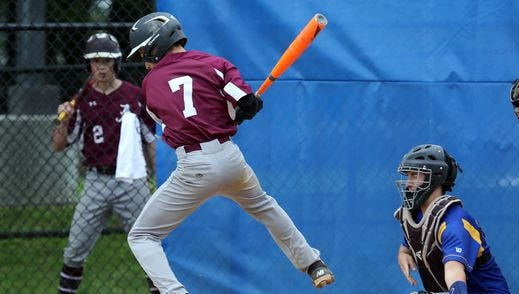 Albertus Magnus' Frank Margiotta is hit by a pitch during their Class B game against Ardsley at Ardsley High School, May 21, 2016.