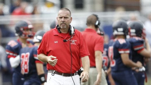 Eastchester coach Fred DiCarlo shown during his team's 22-20 win over visiting Harrison at Eastchester High School on Sept. 3, 2016.