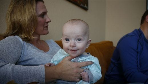 Stacey Baker holds her daughter, Hadley.