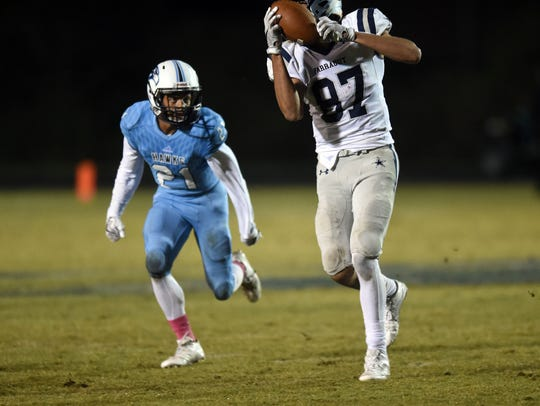 Farragut's Jacob Warren makes a reception during the