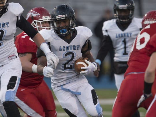 Asbury Park's Namir Argilagos finds a hole in the middle in the 2016 NJSIAA Central Group I championship game against Keyport at Kean University in Union.