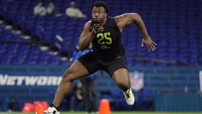 USC offensive lineman Austin Jackson runs a drill at the NFL football scouting combine in Indianapolis, Friday, Feb. 28, 2020.