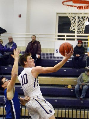 Fowlerville senior Andrew Spalding scores two of his career-high 13 points in a 74-53 victory over Ionia.