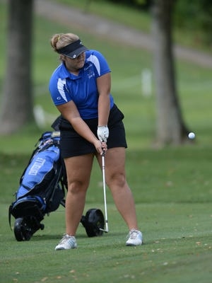 Centerville's Alison Weaver chips to the green during the girls TEC Golf Tournament Saturday, Sept. 12, 2015 at the Liberty Country Club.