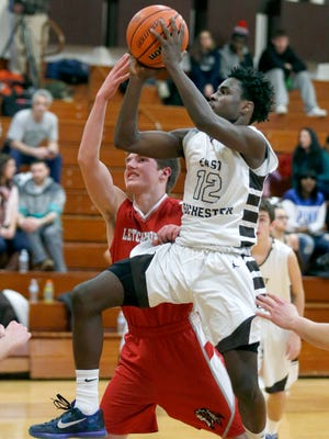 East Rochester's Keith Butler jumps towards the basket under pressure from Letchworth's Donnie Shearing in the second quarter. Top-seeded East Rochester plays No. 4 Clyde-Savannah in the Class C1 semifinals at 8:15 p.m. Tuesday at Palmyra-Macedon.