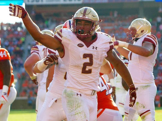 Boston College running back AJ Dillon (2) celebrates after scoring a touchdown during the second half at Clemson Memorial Stadium.