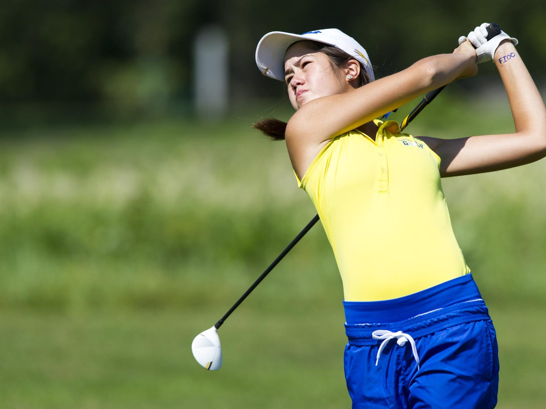 Carmel's Makenzie George shown in 2014 IHSAA Girls Golf Sectionals.