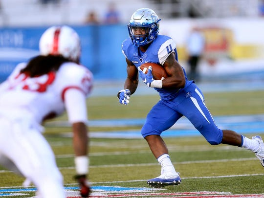 MTSU's I'Tavius Mathers (4) is one of the country's top running backs and has provided another element to the offense this year.