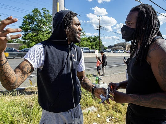 Scumlord Dizzy, left, of Brooklyn, N.Y., and who has family in Willingboro, tries to persuade J.R. Funderburk, of Willingboro, to have his peaceful protesters go to Camden, to become part of a larger group, as they protest the death of George Floyd, on Saturday in Edgewater Park.