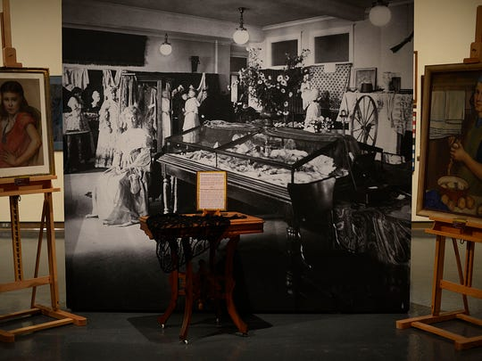 A large photo of an early show organized by the Green Bay Art Club (now named the Green Bay Art Colony) is surrounded by works from the club's artists dating as far back as 1936.