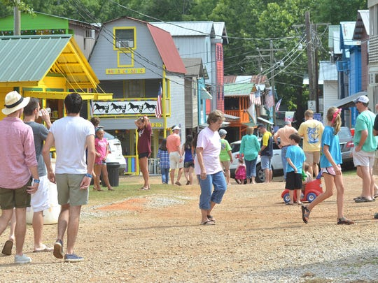 Attendees mill around at the 2013 Neshoba County Fair.