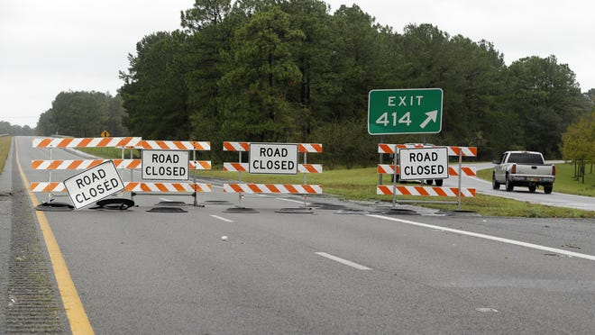 A truck exits Interstate 40 outside Wilmington, N.C., after damage from Hurricane Florence cut off the city Sunday, Sept. 16, 2018.
