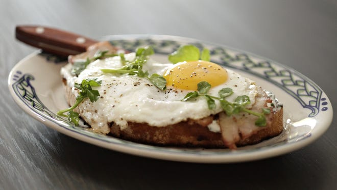 The house-made sturgeon bacon is topped with an egg at Little Cleo's in Phoenix.