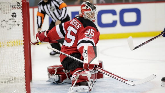 A shot by Tampa Bay Lightning center Vladislav Namestnikov, not pictured, of Russia, enters the net of New Jersey Devils goalie Cory Schneider (35) during the first period of an NHL hockey game, Tuesday, Oct. 17, 2017, in Newark, N.J.