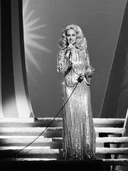 """Tammy Wynette performs """"Stand By Your Man"""" during the CMA Awards show at the Grand Ole Opry House on Oct. 11, 1976."""