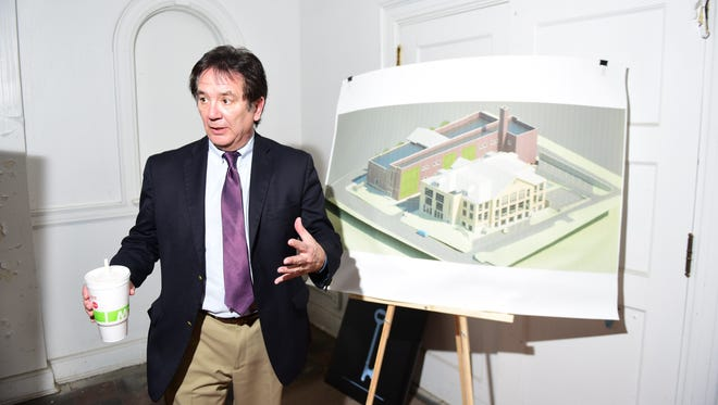 Mike Ross, president of Franklin County Area Development Corp., talks about plans to convert the former Central Junior High School into business offices and apartments, with work to begin this summer.