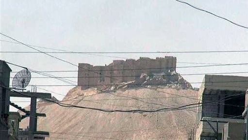 This picture released on Thursday, May 21, 2015 by the website of Islamic State militants, shows the Palmyra castle is seen from the Syrian town of Palmyra that was captured by the Islamic State militants after a battle with the Syrian government forces, Syria. Activist and officials say members of the Islamic State group are conducting search operations in the ancient town of Palmyra where they have detained and killed dozens of people. (The website of Islamic State militants via AP)