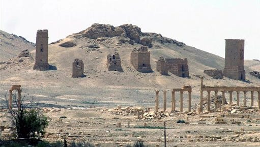 FILE - This file photo released on Sunday, May 17, 2015, by the Syrian official news agency SANA, shows the general view of the ancient Roman city of Palmyra, northeast of Damascus, Syria. Syrian state media and an activist group say Islamic State extremists have beheaded one of the country's most prominent antiquities scholars, Khaled Asaad, 81, on Tuesday, Aug. 18, 2015, in the historic town of Palmyra. (SANA via AP, File)