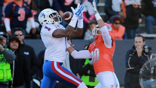 Louisiana Tech's Carlos Henderson pulls in a long pass as UTEP's Nik Needham defends during Saturday's game in El Paso, Texas. Henderson scored a touchdown on the play.