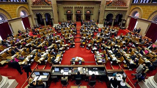 Legislators work in the Assembly Chamber at the Capitol on Wednesday, March 25, 2015, in Albany, N.Y.