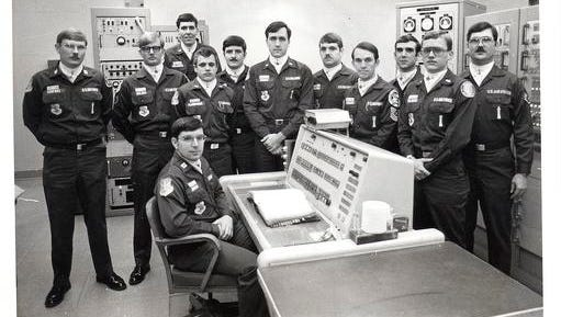"""In this undated photo, Allan Childers, second right, poses with others on a Titan II missile crew at Damascus, Ark. Childers was deputy commander of the crew in 1980, when an airman performing maintenance in the missile silo dropped a socket that pierced the rocket's fuel tank. The accident triggered an explosion 10 hours later, throwing a 9-megaton nuclear warhead into a ditch 200 yards away. PBS' American Experience series will show the documentary """"Command and Control"""" on Tuesday, Jan. 10, 2017."""