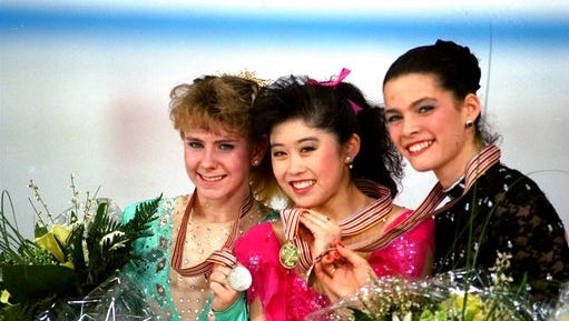 "FILE - In this March 12, 1991, file photo, American skaters (L to R) Tonya Harding, silver; Kristi Yamaguchi, gold; and Nancy Kerrigan, bronze, display their medals after the finals of the World Figure Skating Championships in Munich. A run-of-the-mill good luck tweet from Yamaguchi to Kerrigan is drawing online attention. Yamaguchi tweeted a message to Kerrigan ahead of Kerrigan's performance on Monday's ""Dancing with the Stars"" March 20, 2017, and added ""break a leg."" Kerrigan was hit in the leg before the 1994 Winter Olympics by a man hired by the ex-husband of Harding. Yamaguchi's spokeswoman says ""no ill will was intended."""