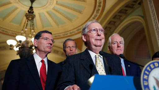 Senate Majority Leader Mitch McConnell of Ky., accompanied by, from left, Sen. John Barrasso, R-Wyo., Sen. John Thune, R-S.D., and Senate Majority Whip John Cornyn of Texas, speaks during a media availability following a policy luncheon, Tuesday, April 25, 2017, on Capitol Hill in Washington.