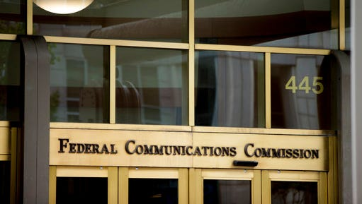 "FILE - This June 19, 2015, file photo, shows the Federal Communications Commission building in Washington. On Tuesday, April 25, 2017, an appeals court upheld ""net neutrality"" rules that treat the internet like a public utility and prohibit blocking, slowing and creating paid fast lanes for online traffic. They have been in effect for a year. The ruling cements the FCC's authority to regulate the internet more strictly. The agency has already proposed making it harder for broadband providers to use consumer data for advertising purposes."