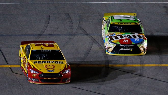 Kyle Busch, right, won the 2015 season finale at Homestead-Miami Speedway to claim his first Sprint Cup championship. Joey Logano, left, finished fourth in that race.
