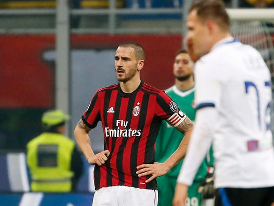 AC Milan's Leonardo Bonucci, left, stands on the pitch after Atalanta's Josip Ilicic scored his side's second goal during the Serie A soccer match between AC Milan and Atalanta at the San Siro stadium in Milan, Italy, Saturday, Dec. 23, 2017. (AP Photo/Antonio Calanni)