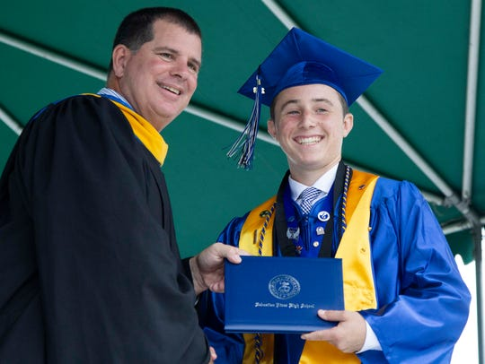Valedictorian Tyler Nagy poses for a photo after receiving