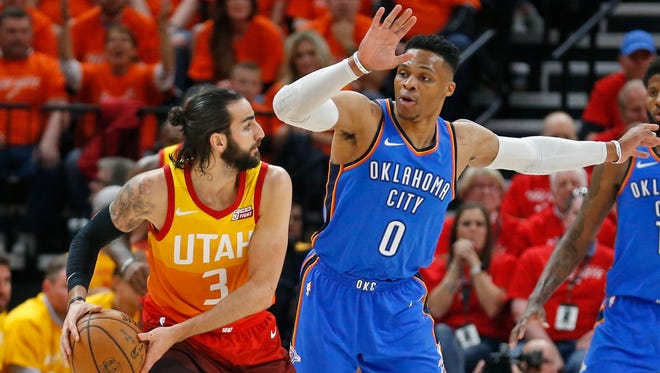 Oklahoma City Thunder guard Russell Westbrook (0) guards against Utah Jazz guard Ricky Rubio (3) in the first half during Game 3 of an NBA basketball first-round playoff series Saturday, April 21, 2018, in Salt Lake City.