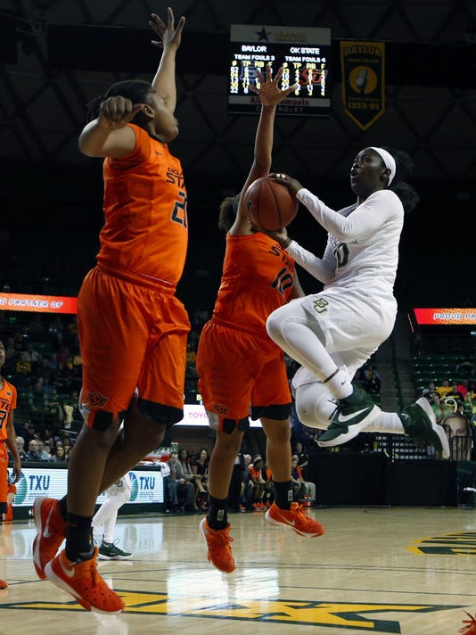 Baylor guard Alexis Jones, right, drives on Oklahoma State guard Sydney Walton, center, and forward LaTashia Jones , left, in the second half of an NCAA college basketball game, Wednesday, Feb. 17, 2016, in Waco, Texas. Baylor won 66-41. (AP Photo/Jerry Larson)