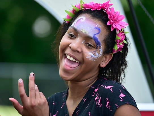 Yerianna Suero, 13, wears her face paint as she spends