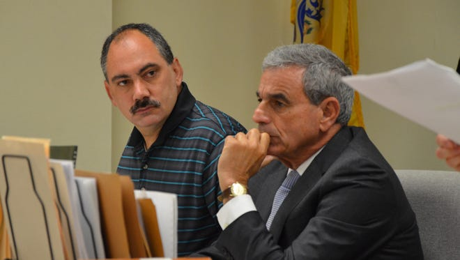 Former Pine Hill Middle School art teacher Charles Reilly (left) stands with his attorney, Robert Agre, Friday. Reilly received a 15-year prison sentence for having sexually explicit conversations with students he taught.