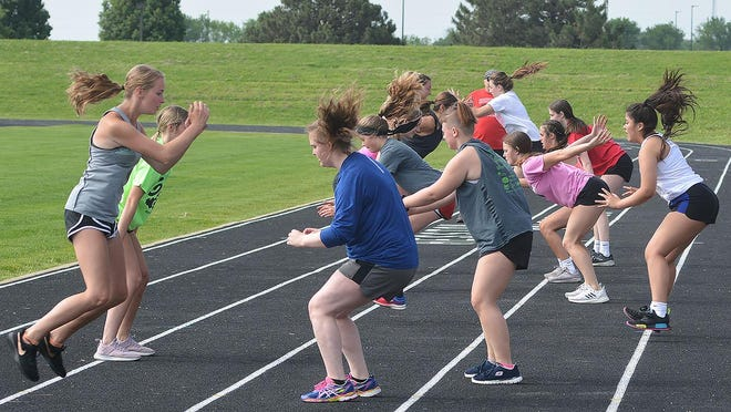 Hesston High School freshman and sophomore athletes work out during a recent conditioning session at Hobbs Stadium.