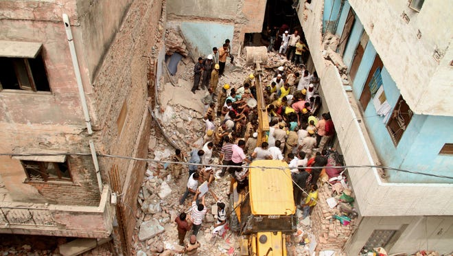 Search and rescue operations continue on the site of a building collapse in Delhi, India. At least seven people are feared killed after a 50 year old four-story building collapsed on early 28 June in the Inderlok area of Delhi.
